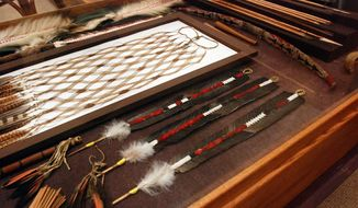 ** FILE ** In this photo taken on Aug. 5, 2009, condor feathers were used to make this White Deerskin Dance regalia used by the Karuk Tribe, displayed at the Clark Historical Museum in Eureka, Calif. The three feather wands at lower right are a composite of several feathers. The neighboring Yurok Tribe, which also used condor feathers in dance regalia, is studying whether condors can be reintroduced in the Klamath River canyon, where they have not soared for a century. (Associated Press)
