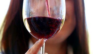 **FILE** Antonella Talamonti is served with a glass of Montepulciano D'abruzzo in Loreto Aprutino, Abruzzo, Italy, Friday, Sept. 10, 2004. (AP Photo/Gregorio Borgia)
