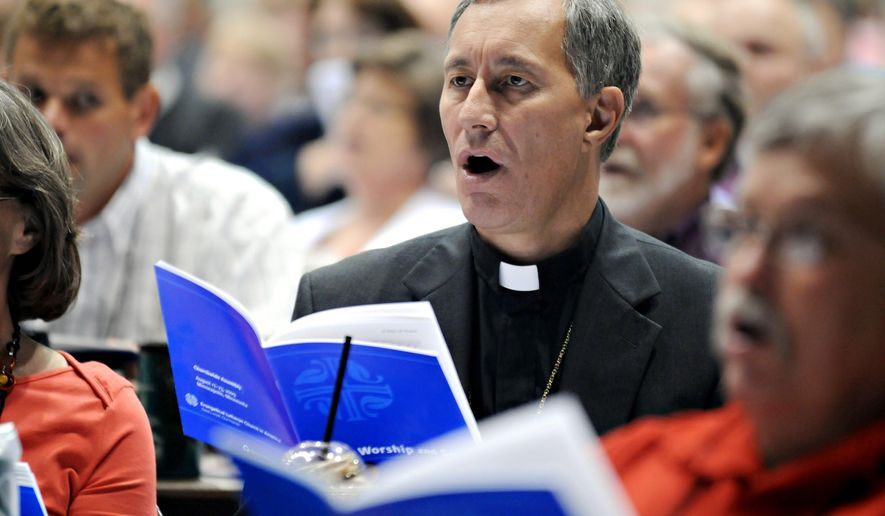 Bishop Duane Pederson of Rice Lake, Wisc. joins more than 1,000 other voting members in a song during the Evangelical Lutheran Church of America assembly on Wednesday at the Minneapolis Convention Center.