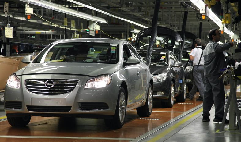 Workers are pictured on the assembly line of Opel's Insignia model at the company's plant in Ruesselsheim, Germany, in 2008. General Motors announced on Thursday, Dec. 5, 2013, that it will end shipments of Chevrolet cars to the Continent to focus on the German-based Opel and U.K.-based Vauxhall, its main brands in Europe. (AP Photo/Daniel Roland)