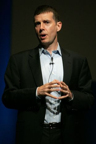 David Plouffe, Mr. Obama's former campaign manager, works for AKPD Message and Media, an ad firm that's part of a $24 million Obamacare public relations drive. (Associated Press)