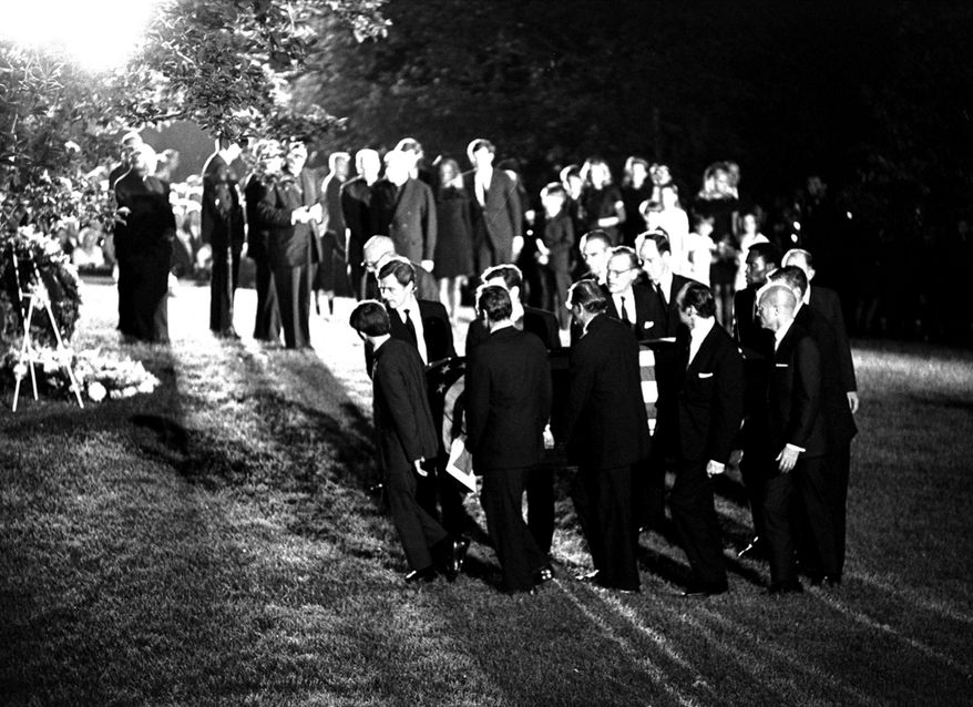 The casket of Robert F. Kennedy is carried to the gravesite at Arlington National Cemetery, June 8, 1968.  The pallbearers are led by Kennedy's oldest son, Joseph.  Ted Kennedy is second from left.  (AP Photo/stf)