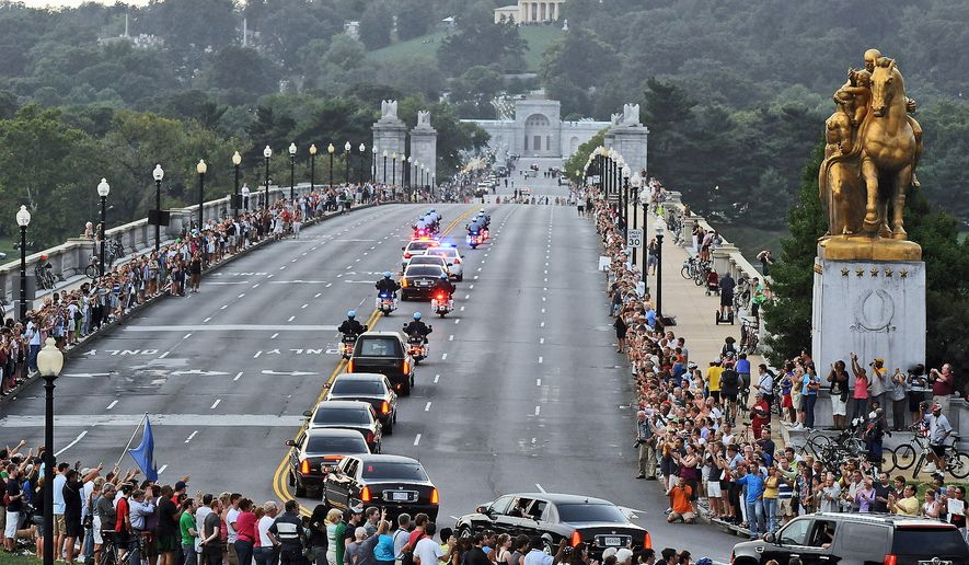 The motorcade of Senator Edward Kennedy crosses Memorial Bridge on route to Arlington National Cemetery where a burial service is held for the late Senator in Washington, D.C., Saturday, August 29, 2009. (Astrid Riecken/The Washington Times)
