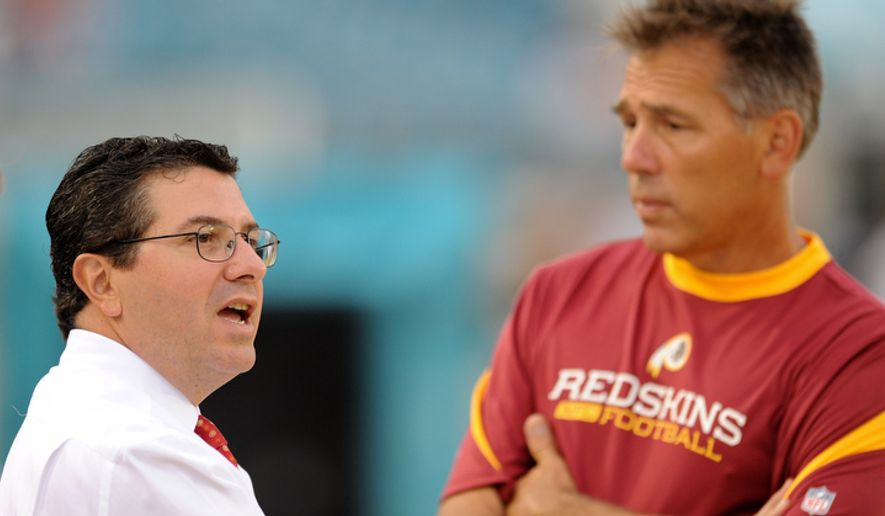Head coach of the Washington Redskins Jim Zorn (right) speaks with owner Daniel Snyder before the Redskins play the Jacksonville Jaguars. (Michael Connor / The Washington Times)