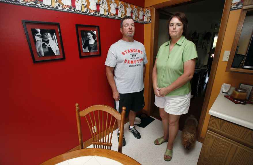 John Nardini and his wife, Peggy, of Madrid, Iowa, sent twins Michael and Micah, whose photo are displayed at left, off to college last year. (Associated Press)