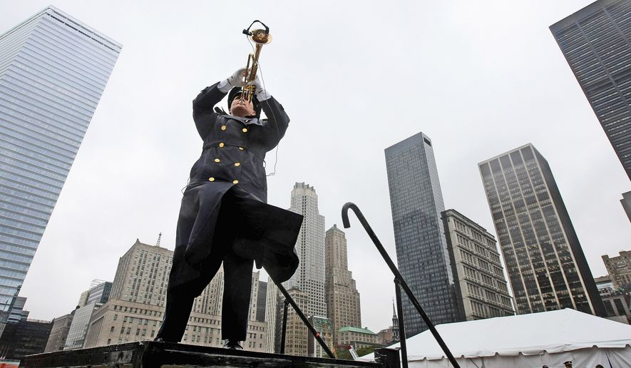 """""""Taps"""" is played at Ground Zero during a 9/11 memorial ceremony on September 11, 2009 in New York City. Family of the victims, government officials and others gathered at the annual ceremony to remember the attacks that killed more than 2,700 people with the destruction of the World Trade Center, the crash at the Pentagon and United 93 in Shanksville, Pennsylvania on September 11, 2001.  (Photo by Chang W. Lee-Pool/Getty Images)"""