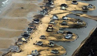 Homes along the waterfront near Galveston, Texas, are severely damaged a day after Hurricane Ike made landfall. (Rod Lamkey Jr./The Washington Times)