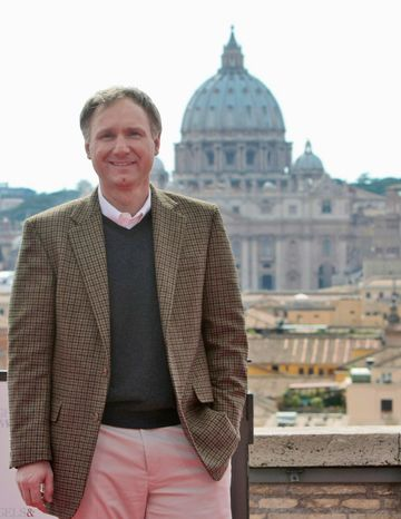 "Novelist Dan Brown poses during a photo call for the world premiere of the movie ""Angels & Demons"" in Rome in 2009. (AP Photo/Andrew Medichini)"