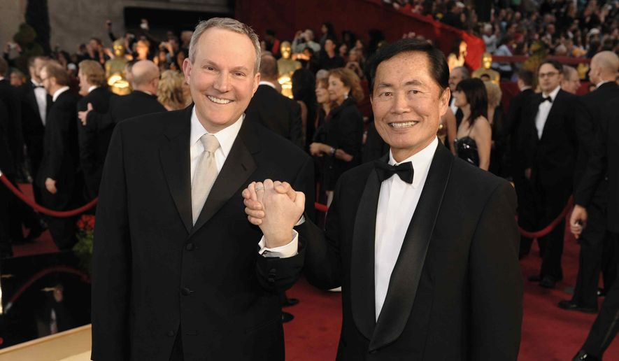 In this Feb. 22, 2009, file photo, actor George Takei, right, and Brad Altman arrive for the 81st Academy Awards in the Hollywood section of Los Angeles. (AP Photo/Chris Pizzello, file)