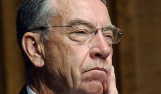 """Senate Judiciary Committee member Sen. Charles Grassley, R-Iowa, listens to FBI Director Robert Mueller testify on Capitol Hill in Washington, Wednesday, Sept. 16, 2009, during the committee's FBI oversight hearing. Grassley, also a member of the Senate Finance Committee, is one of the """"Gang of Six"""" involved in the health care negotiations. (AP Photo/Susan Walsh)"""