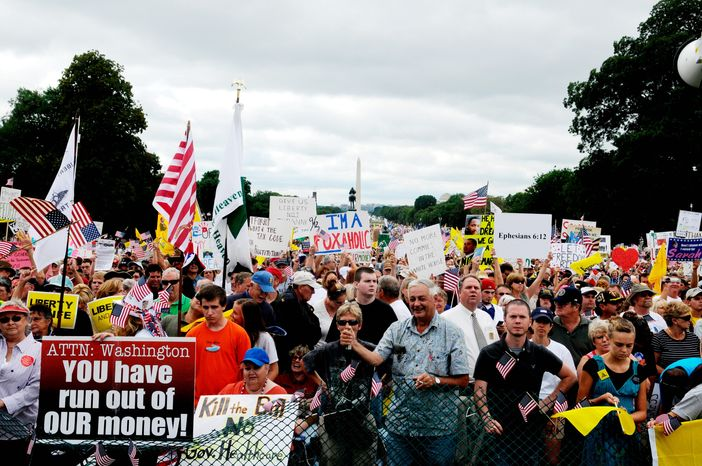 """**FILE** An enormous crowd takes part in the Sept. 12 march on Washington to protest government spending and health care reform proposals. The field plan for a series of grassroots demonstrations Tuesday to push President Obama's health care agenda show the events will be tightly scripted with plans for """"escalation,"""" but organizers insist there is no comparison to rowdy town hall meetings and """"tea party"""" protests challenging White House policies that they say conservatives staged. (Mary F. Calvert/The Washington Times)"""