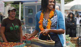 Former first lady Michelle Obama shopped for fresh produce at Freshfarm Market's farmers' market on Vermont Avenue near the White House in Washington, Sept. 17, 2009. (AP Photo/Manuel Balce Ceneta) ** FILE **