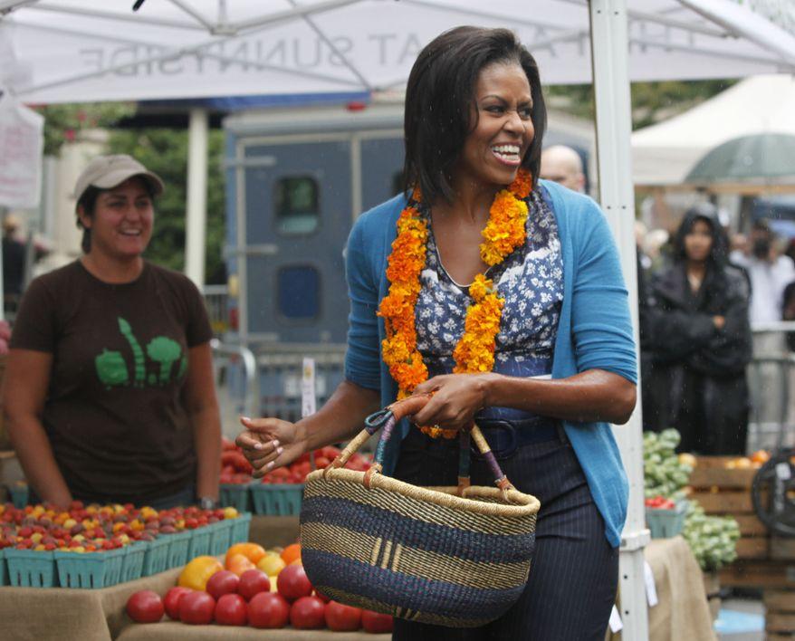 Former first lady Michelle Obama shopped for fresh produce at Freshfarm Market's farmers' market on Vermont Avenue near the White House in Washington, Sept. 17, 2009. (AP Photo/Manuel Balce Ceneta) ** FILE **