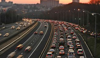 ** FILE ** This Dec. 14, 2006, file photo shows Washington traffic at rush hour on Interstate 395 near Seminary Road in Alexandria, Va. (AP Photo/Jacquelyn Martin, File)