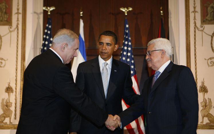 President Obama meets with Israeli Prime Minister Benjamin Netanyahu (left) and Palestinian President Mahmoud Abbas in New York on Tuesday, Sept. 22, 2009, on the sidelines of the U.N. General Assembly meeting. (AP Photo/Charles Dharapak)