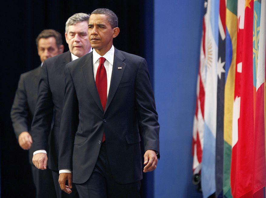 President Obama, followed by British Prime Minister Gordon Brown (center) and French President Nicolas Sarkozy, arrive Friday to make a statement on Iran's nuclear facility during the G-20 Summit in Pittsburgh. (Associated Press)