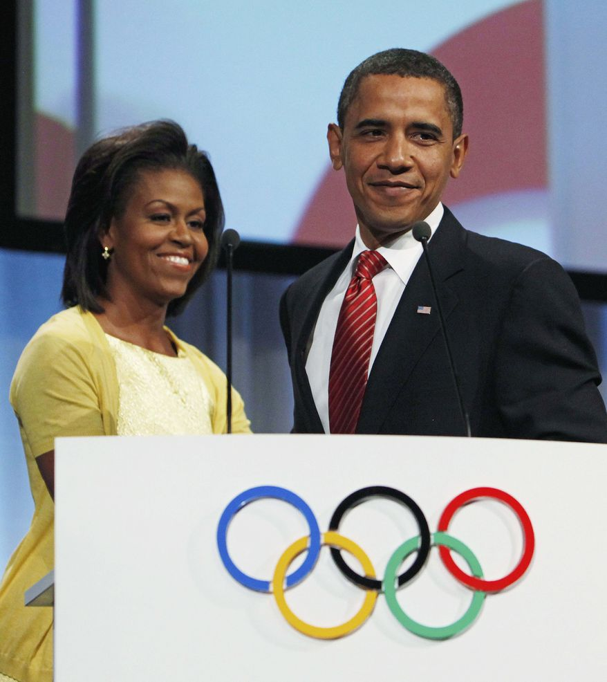 **FILE ** U.S. President Barack Obama is introduced by first lady Michelle Obama before he makes a presentation in support of Chicago as the host city for the 2016 Summer Olympic Games, Friday, Oct. 2, 2009. (AP Photo/Charles Dharapak, Pool)