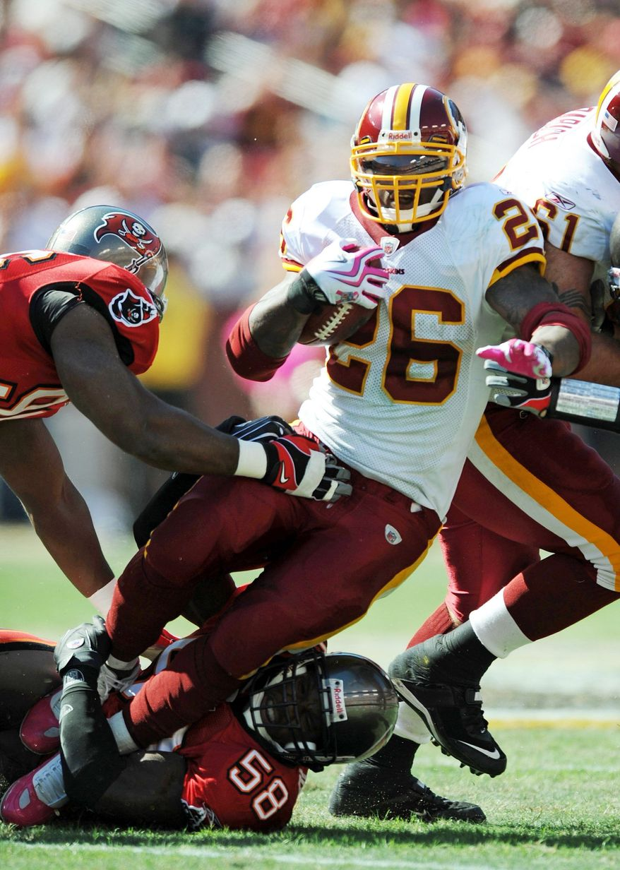 Peter Lockley / The Washington Times Clinton Portis ran for 98 yards on 25 carries Sunday against the Buccaneers.