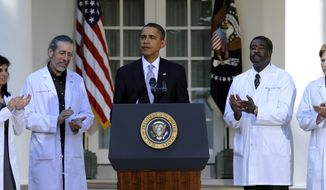 **FILE** President Obama stands with (from left) Dr. Mona Mangat of St. Petersburg, Fla.; Dr. Hershey Garner of Fayetteville, Ark.; Dr. Richard Evans of Dover-Foxcroft, Maine; and Dr. Amanda McKinney of Beatrice, Neb., in the Rose Garden of the White House in Washington on Oct. 5, 2009, during an event with doctors from around the country to discuss health care reform. (Associated Press)