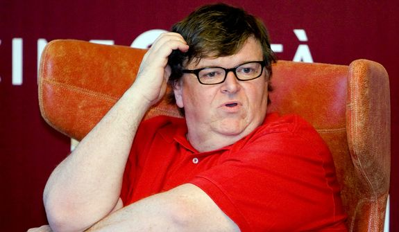 U.S. filmmaker Michael Moore attends a meeting at the 66th edition of the Venice Film Festival in Venice, Italy, in this Saturday, Sept. 5, 2009, file photo. (AP Photo/Domenico Stinellis) ** FILE **