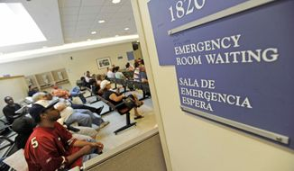 ** FILE ** In this July 30, 2009, file photo, patients wait in the emergency room at Cook County Hospital, one of Chicago's safety net hospitals. A private trade group said Monday, Oct. 5, 2009, its measure of the U.S. service sector grew in September for the first time in 13 months. (AP Photo/Paul Beaty, file)
