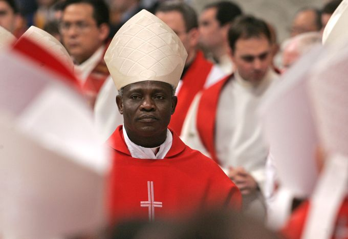 ** FILE ** Cardinal Peter Kodwo Appiah Turkson of Ghana attends a Mass for Pope John Paul II in St. Peter's Basilica at the Vatican on April 13, 2005. (AP Photo/Pier Paolo Cito, File)