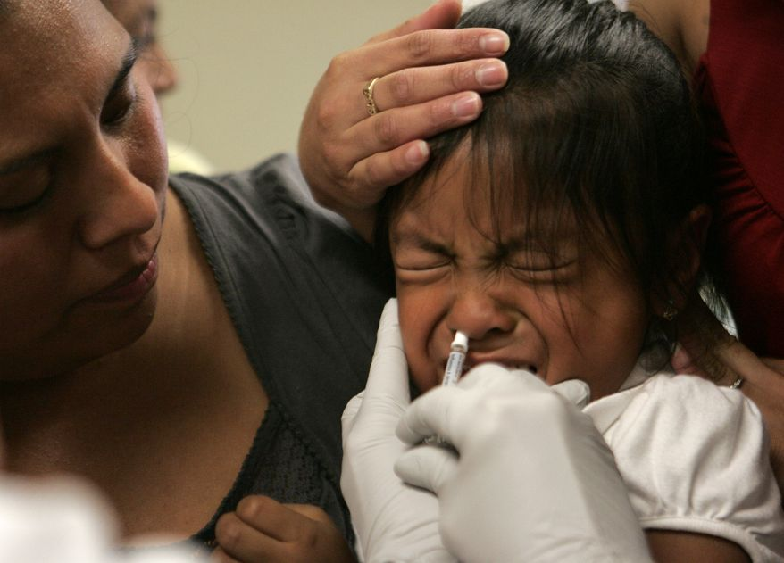 Amparo Martinez, left, watches as her daughter, Sorayo Martinez, 4, is given a dose of swine flu vaccine in Oregon City, Ore., Tuesday, Oct. 6, 2009. Children and health workers are the first to receive vaccines from the first batch to hit Oregon. (AP Photo/Don Ryan)