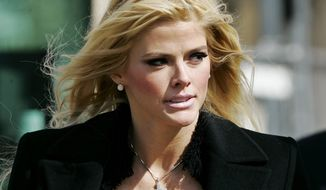 ** FILE ** Anna Nicole Smith leaves the U.S. Supreme Court after her bid to collect millions of dollars from the estate of her husband, J. Howard Marshall II, was presented on Feb. 28, 2006, in Washington. The court ruled on Monday, May 1, 2006, that Miss Smith, a one-time stripper and Playboy Playmate, could pursue part of Marshall's oil fortune. (AP Photo/Manuel Balce Ceneta)