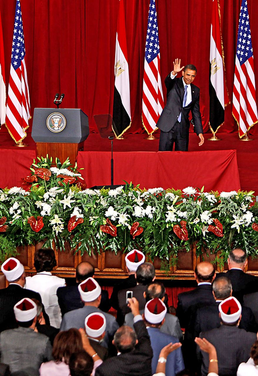 """This June 24, 2009 file photo shows U.S. President Barack Obama waving at the audience, after delivering a speech at Cairo University in Cairo, Egypt. President Barack Obama won the 2009 Nobel Peace Prize on Friday Oct. 9, 2009 for """"his extraordinary efforts to strengthen international diplomacy and cooperation between peoples,"""" the Norwegian Nobel Committee said, citing his outreach to the Muslim world and attempts to curb nuclear proliferation. (AP Photo/Nasser Nasser, File)"""