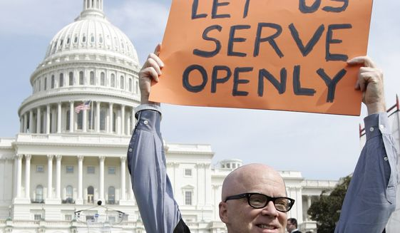 """**FILE** In this March 26, 2007 photo, Andrew Chapin of New York City takes part in a rally on Capitol Hill in Washington supporting legislative efforts to repeal the military's """"Don't Ask, Don't Tell"""" policy regarding gay soldiers. (Associated Press)"""