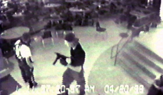 Eric Harris (left) and Dylan Klebold are seen from a security camera image at Columbine High School in Littleton, Colo., on April 20, 1999, during their shooting rampage. (Associated Press)