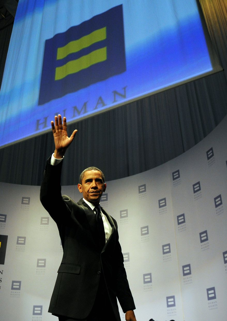 """US President Barack Obama leaves after speaking at the Human Rights Campaign National Dinner at the Walter E. Washington Convention Center in Washington on October 10, 2009. Obama vowed to repeal the """"don't ask, don't tell"""" policy which prevents US servicemen from revealing their homosexuality. AFP PHOTO/Jewel SAMAD (Photo credit should read JEWEL SAMAD/AFP/Getty Images)"""