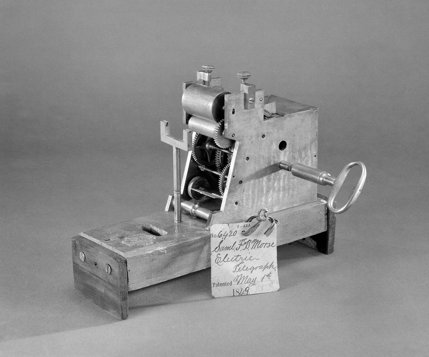 President Obama has placed examples of American inventions on his office shelves, including Samuel F.B. Morse's 1849 patent model of his Electric Telegraph. (Associated Press/Smithsonian Institution)