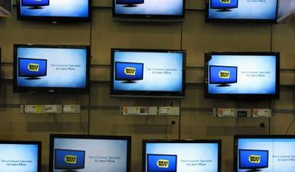 ASSOCIATED PRESS Flat-screen TVs are displayed at a Best Buy in Danvers, Mass. The retailer has ratcheted up its offerings.