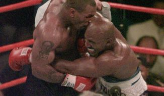 "Mike Tyson and Evander Holyfield, seen here in the 1997 match when Mr. Tyson bit off part of Mr. Holyfield's ear, will meet Friday on ""The Oprah Winfrey Show."""
