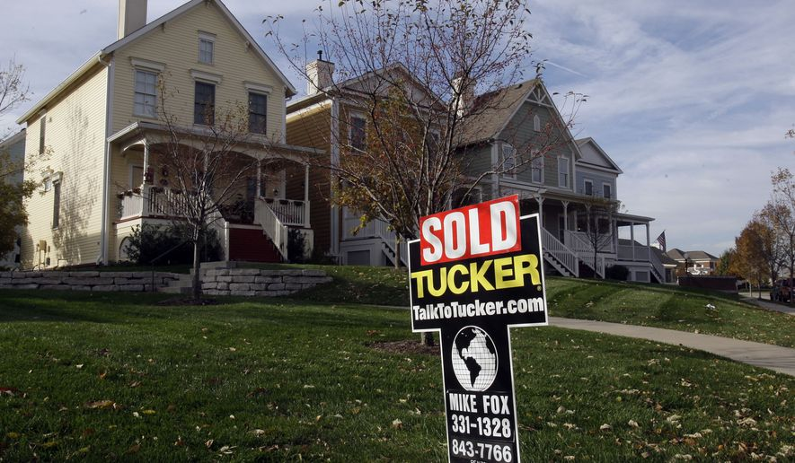 """**FILE** A """"sold"""" sign is shown in front of an Indiana home. (AP Photo/Michael Conroy/File)"""