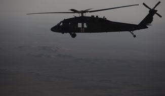 **FILE** A U.S. Army Black Hawk medical evacuation helicopter flies on a mission over Helmand Province, Afghanistan, Thursday, Oct. 22, 2009.
