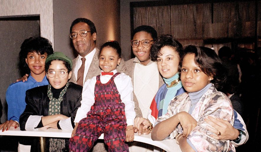 """Bill Cosby poses with cast members of the 1980s sitcom """"The Cosby Show."""" (Associated Press)"""