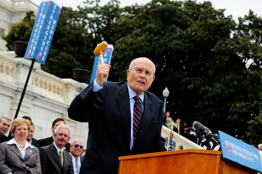 ** FILE ** Rep. John Dingell (D-MI) wields his old gavel as he talks about the issue of health care, during a press conference regarding H-232, the Affordable Health Care Act, on the west steps of the Capitol in Washington, D.C., Thursday, Oct. 29, 2009. (Rod Lamkey Jr./The Washington Times)