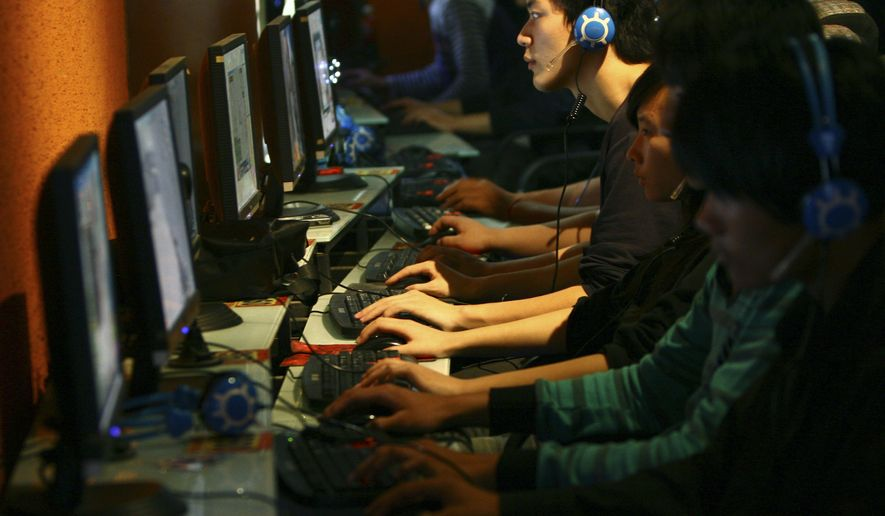 People use computers at an Internet cafe in Fuyang in central China's Anhui province Thursday, Oct. 29, 2009. The nonprofit body that oversees Internet addresses approved Friday, Oct. 30, 2009 the use of Hebrew, Hindi, Korean, Chinese and other scripts not based on the Latin alphabet in a decision that could make the Web dramatically more inclusive. (AP Photo)