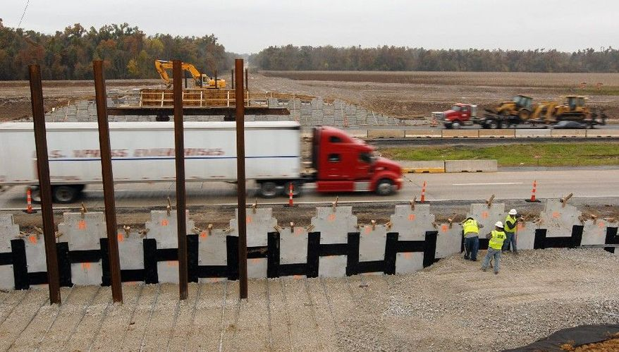 Construction employees work on an overpass over Highway 71 near the southwestern Missouri city of Lamar in 2009. The project was part of President Obama's stimulus package. (Associated Press File)