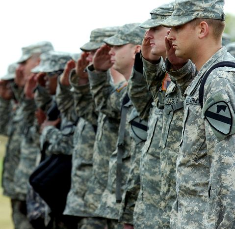**FILE** In a Dec. 11, 2007 file photo, soldiers from the 1st Cavalry Division and 13th Sustainment Command stand in formation during a homecoming ceremony at Fort Hood, Texas. (Associated Press)