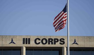 The U.S. flag flies at half staff in front of the Army's III Corps headquarters at Fort Hood, Texas, on Friday, Nov. 6, 2009. (AP Photo/LM Otero)