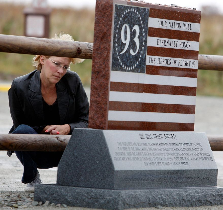 Jan Edwards of Lebanon, Ohio, stops to read the inscription on a marker at the temporary memorial for those who died in the Flight 93 crash on Sept. 11 in Shanksville.