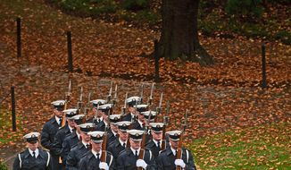 Soldiers prepare to participate in a Veteran's Day wreath-laying ceremony, attended by President Barack Obama, wife Michelle Obama, Vice President Joseph Biden and wife Jill Biden, at the Tomb of the Unknown Soldier at Arlington National Cemetery in Arlington, Va., Wednesday, November 11, 2009.    (Allison Shelley/  The Washington Times)