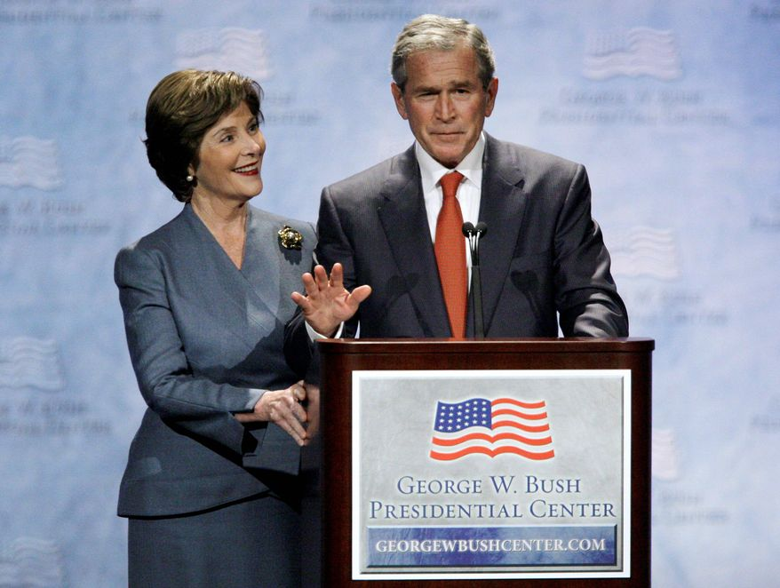 ** FILE ** Former first lady Laura Bush and former President George W. Bush visit Southern Methodist University in Dallas, the future site of the George W. Bush Presidential Center, in November 2009. (Associated Press)
