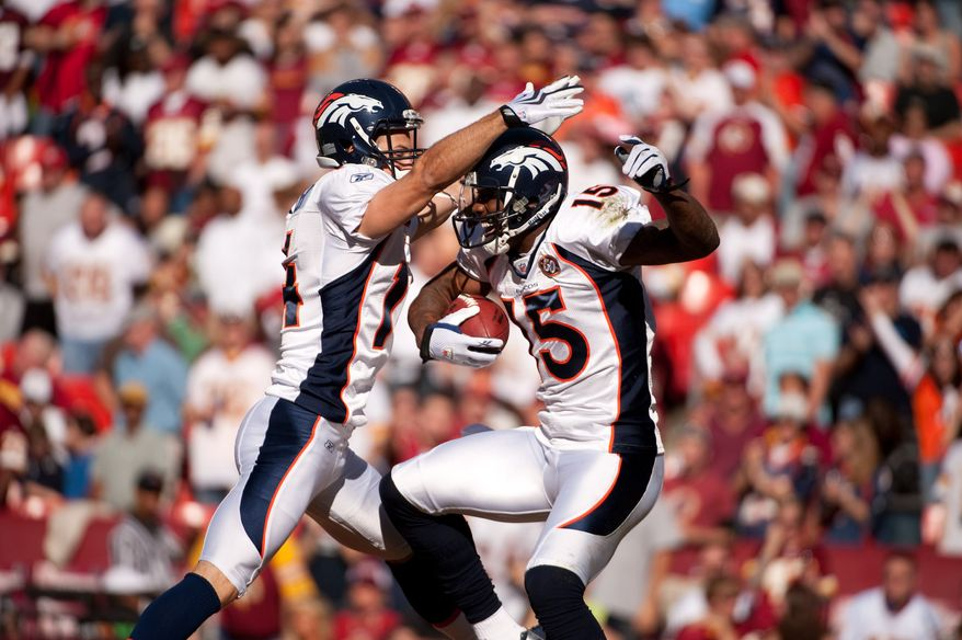 Broncos Brandon Marshall (15) celebrates a touchdown against the Washington Redskins on Nov. 15, 2009. (Michael Connor / The Washington Times)