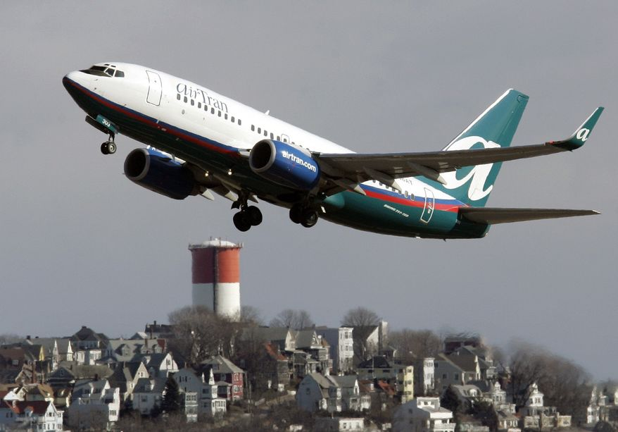 ** FILE ** An AirTran Airways Boeing 737 takes off from Logan International Airport in Boston in January 2007. AirTran was among the top three airlines for on-time performance in October 2010. (AP Photo/Michael Dwyer, File)