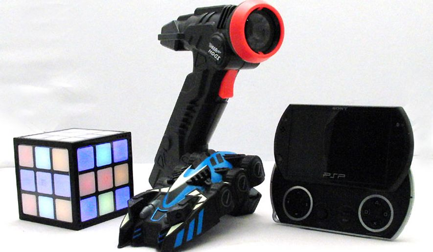 From left; Techno Source's Rubik's TouchCube, Spin Master's Zero Gravity Laser and Sony's PSPgo. (Photo by Jacquie Kubin/Special to The Washington Times)