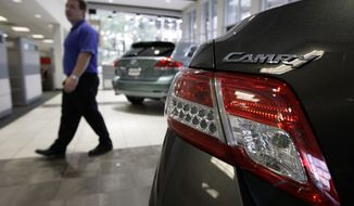 ** FILE ** In this Oct. 1, 2009, photo, a top selling Toyota Camry is on display in the showroom at the McGeorge Toyota dealership in Richmond, Va. (AP Photo/Steve Helber)